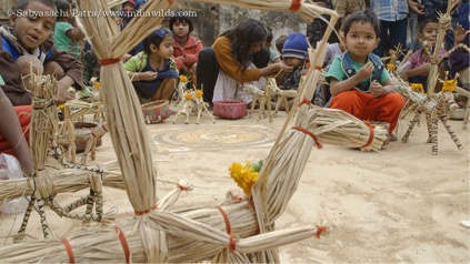 Kids playing with straw horse
