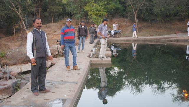 Gunmen hired by Tikamgarh municipality president patrol the Baarighat stop dam which is the main source of potable water in the area. (HT Photo)