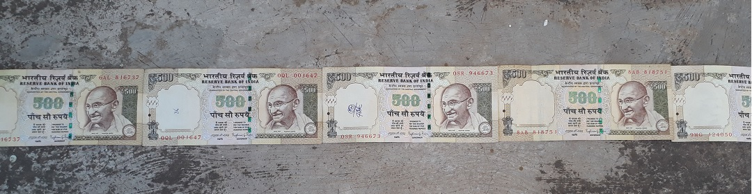 500 Rupee notes placed end to end