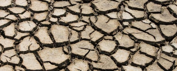 Cracked mud of the dried up fields due to famine in India
