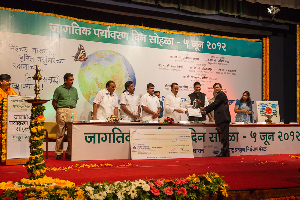 Sabyasachi Patra receiving the award from CM